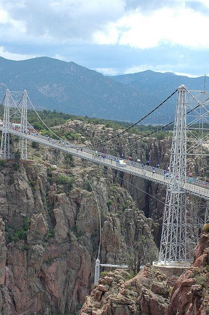 The Royal Gorge Bridge near Canyon City, Colorado spans the Arkansas River at a height of 1,053 feet..Awesome!  Have been across this bridge an you can see thru the wooden slats. Don' t do it if u have a fear of heights!