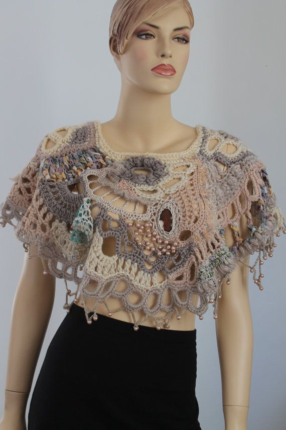 Hey, I found this really awesome Etsy listing at http://www.etsy.com/listing/152703416/chunky-freeform-crochet-poncho-brown