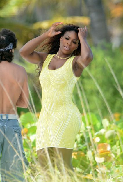 April 15, 2013: World #1 Serena Williams poses during a photo shoot in Miami Beach.  #WoW Herve Leger V-Neck Bandage Dress, Neon Yellow.