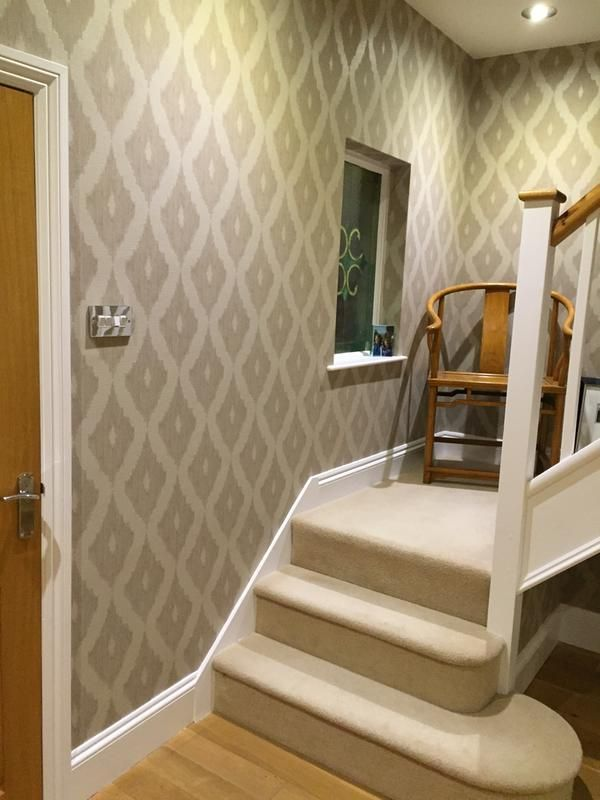 Beautiful hallway using our Kelly Hoppen Ikat wallpaper in Soft Grey/White