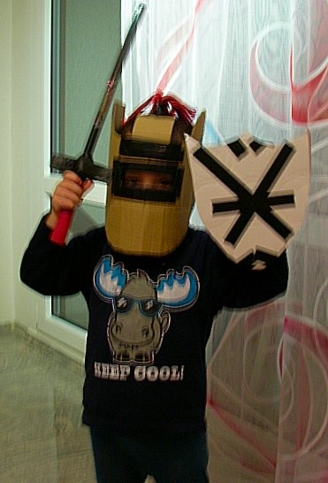 My Grandson with helmet and sheild made out of cardbord and Duck Tape.