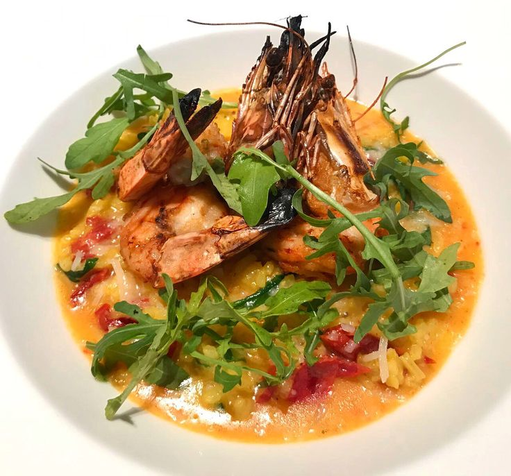 Saffron risotto, semi-dried tomatoes, aged parmesan and king prawns