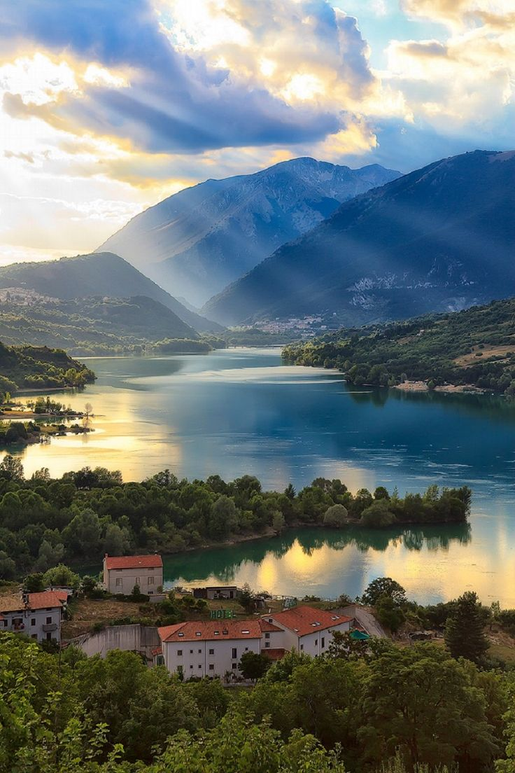 Barrea Lake, Italy Giovanni Di Gregorio - http://500px.com/photo/80993255/sunrays-over-the-lake-by-giovanni-di-gregorio?from=popular&only=Landscapes
