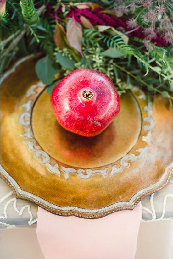 gold wedding ideas with pomegranate in center of place setting #weddingreception #tabledecor #weddingchicks http://www.weddingchicks.com/2014/02/13/romance-in-the-woods-wedding-inspiration/