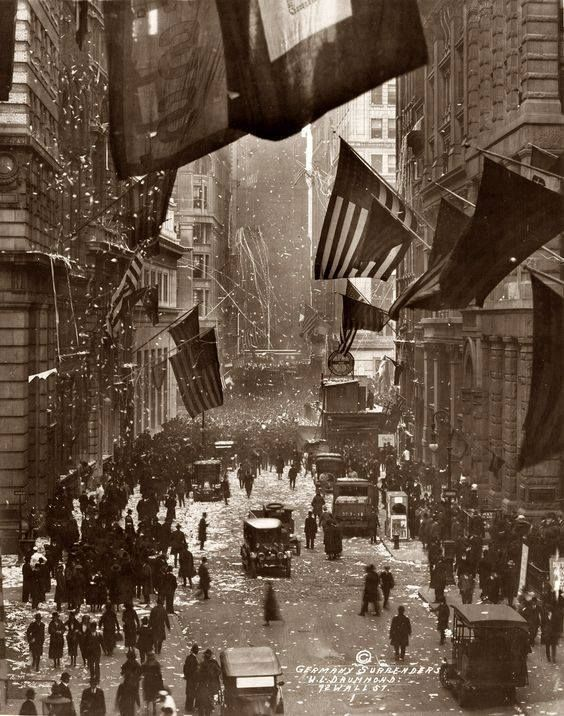"What we call ""Veterans Day"" today was originally ""Armistice Day"" marking the day WWI ended. In this photo Americans celebrate news of German surrender on Wall Street November 1918."