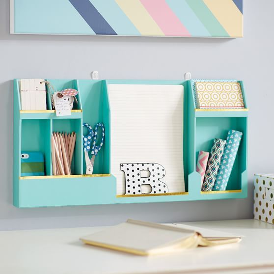 Keep desk supplies tidy with this wall organizer — the pretty gold trim means it doubles as decor. $29, pbteen.com     - HouseBeautiful.com