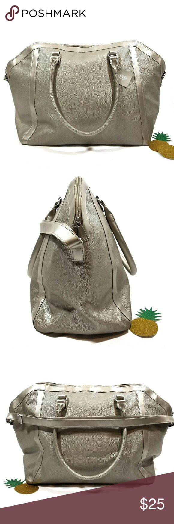 """Large ULTA tote This tote is a champagne/gold color. Length is approx 15"""", width is approx 24"""". Adjustable strap is approx 27"""" and can be extended to approx 48"""". Please note: there is a very small flaw on the side of the bag (see last pic) Ulta Bags Totes"""