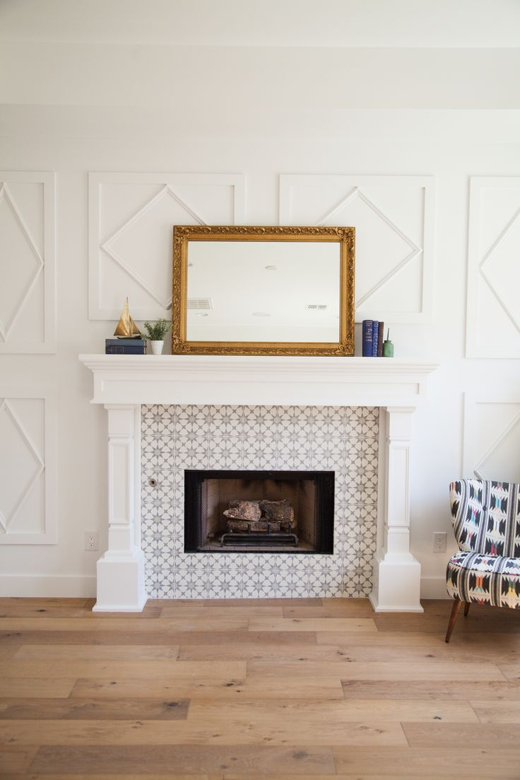 Custom millwork fireplace mantel and surround with inlaid cement tile border - by Rafterhouse. Phoenix, AZ