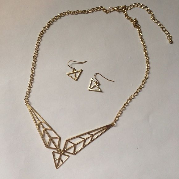 "Last Day⬇️ Triangle necklace and earrings Triangle design necklace and earring set in gold tone. Necklace has a cool geometric, dimensional design. Triangular earrings with fish hook hangers. 19"" necklace has lobster claw closure with 3"" extender. Not interested in trades. 12 Jewelry Necklaces"