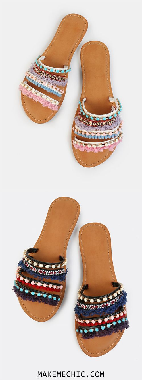 Add that splash of color to your attire with the Vibrant Embellished Slides. Features slip on sandals with beautiful casted jewels, tribal print embroidery and colorful tassel trimmings. Finished with a flat sole. Play up your outfit with a white swing skirt and colorful earrings.