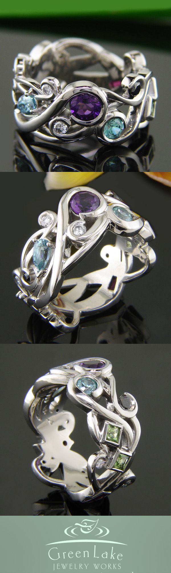Custom #MothersRing in pierced palladium with family birthstones: White and black #diamonds, peridot, pink tourmaline, aquamarine, amethyst, and ruby. #GreenLakeJewelry