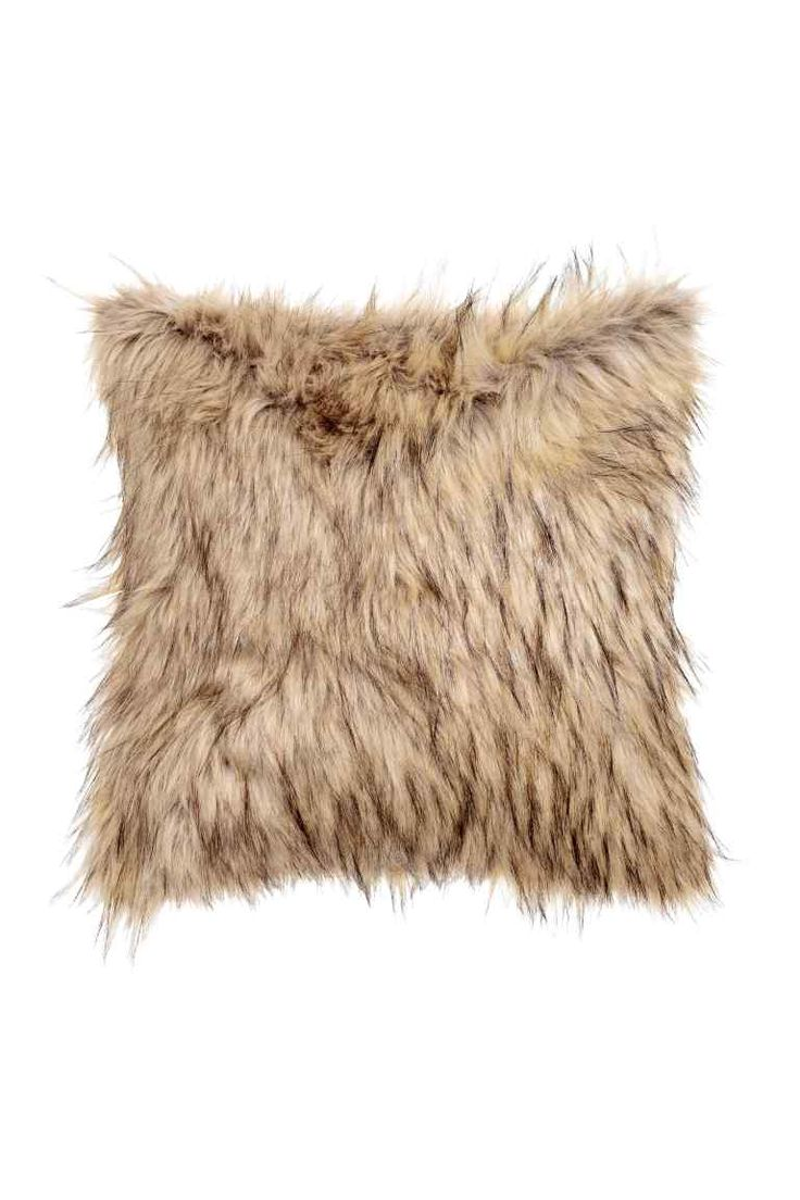 Faux fur cushion cover: Cushion cover in faux fur with a woven cotton back and concealed zip.