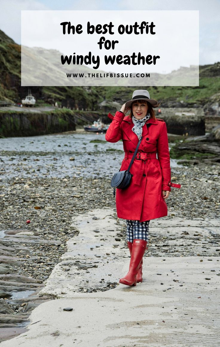 Outfit for windy and rainy weather. Red trench coat and red Hunter Tour wellington boots which are perfect for travelling.