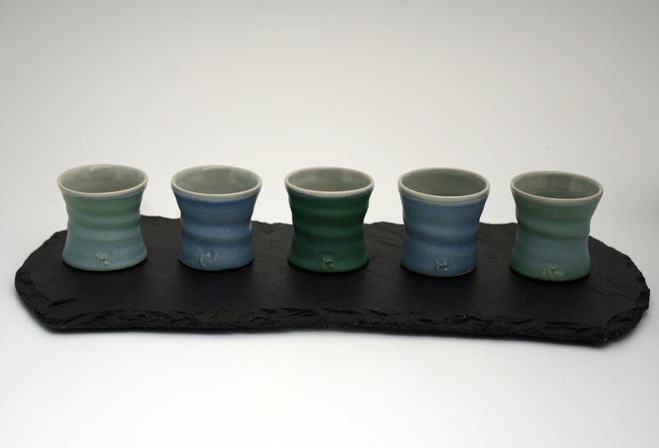 Small beakers on slate