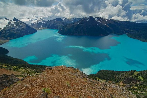 Garibaldi Lake, British Columbia, Canada   A turquoise-colored alpine lake, this is located 37 km north of Squamish and 19 km south of Whistler. The lake lies within Garibaldi Provincial Park, which features mountains, glaciers, trails, forests, flowers, meadows, waterfalls. The park is a wildlife protected area. The trails in the area are promoted as being among the most beautiful on Earth.  