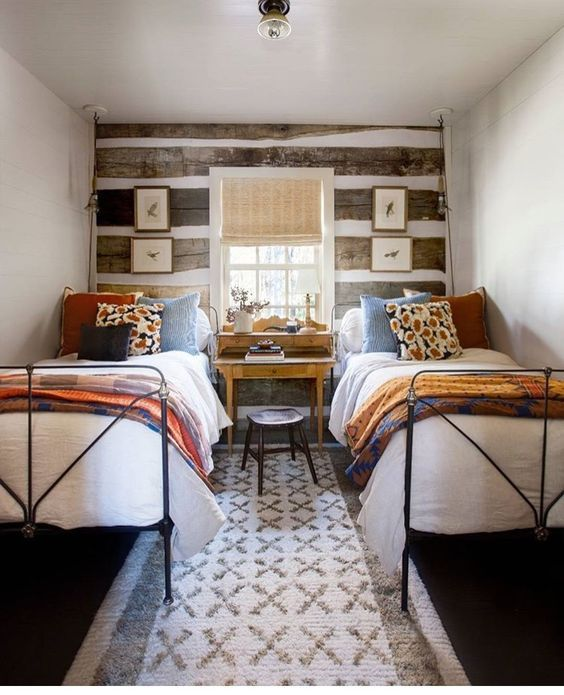matching pair of simple twin iron beds we did for a clients vacation log cabin
