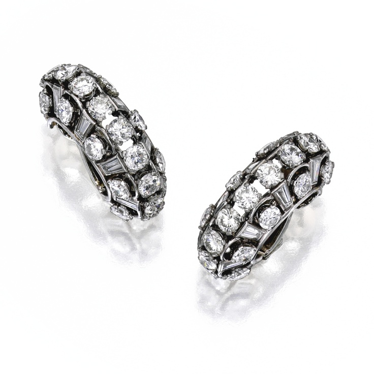 pair of platinum and diamond earclips bulgari of openwork design set with numerous round and baguette diamonds weighing carats