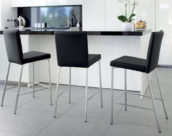 Romy Domitalia  The stool Romy, due to its simplicity, elegance and comfort, is suitable for all environments. The fixed height structure in painted steel comes with 4 legs and footrest on three sides, while the squared seat with its backrest padded in bloom can be made in neutral colors. All this makes Romy a stool suitable for many styles of furniture.  http://www.martinelstore.com/en/prod/chairs/stool/romy-domitalia-1844.html