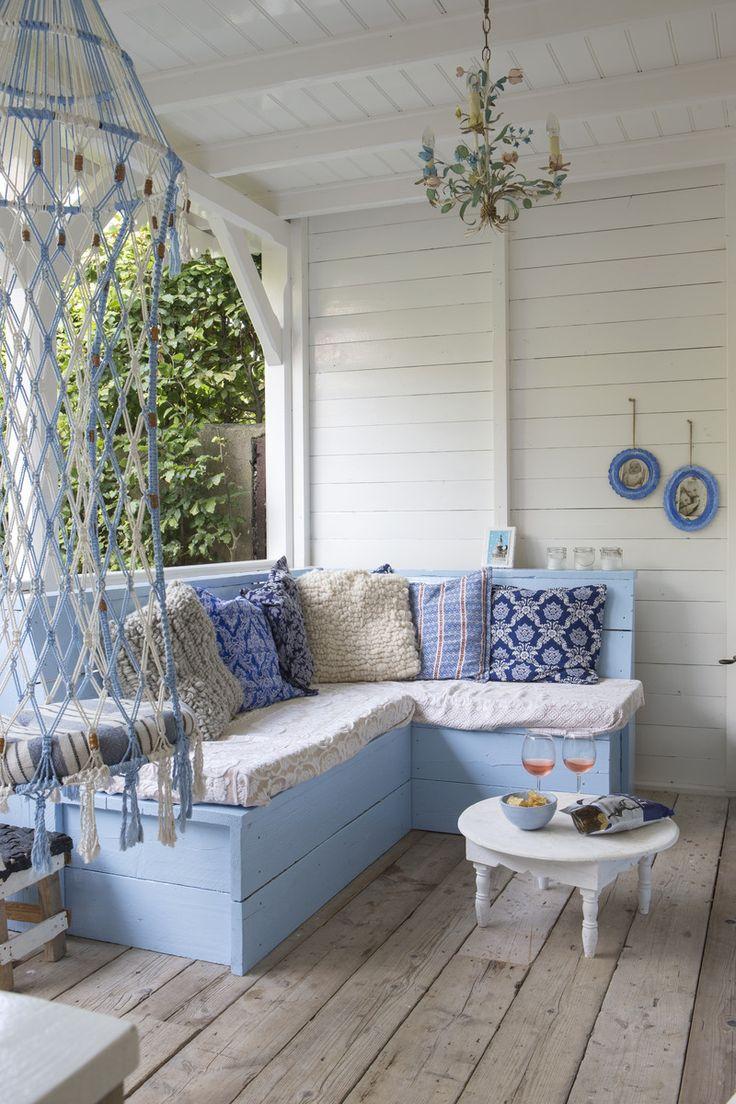 Boho porch...love the macrame hanging.