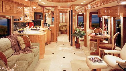 An RV living room! One of the top RV's around, this luxury RV starts at 500,000. Forget about gas mileage if you can afford this.