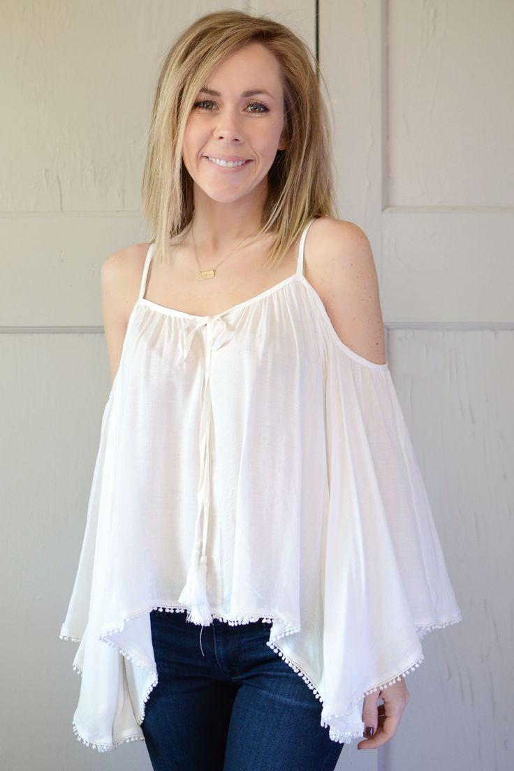 Open shoulder design and bell sleeves help you put your best boho foot forward. This top has a free expression & leaves an even better impression. This effortless chic look is featured in a flawless w