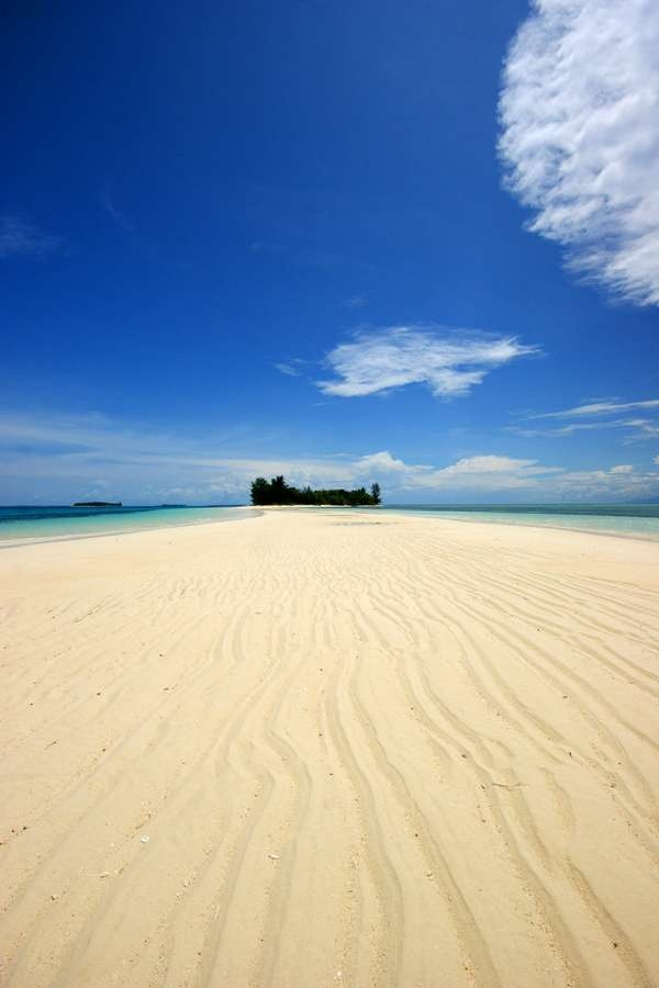A long white sandy beach connects Dodola Besar Island and Dodola Kecil Island -- North Maluku, Indonesia