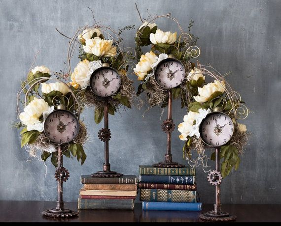These lovely and unique steampunk wedding table flower clock centerpieces are so beautiful and unique. There are 4 centerpiece available. 2 at 25 tall