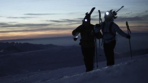 Snow Shoeing, Ski Mountaineering, Mountain Sports, Snow-Covered, Bernese Alps, Snowscape, High Mountain Regions, Winter Sports, Sunset, Dusk, Recreational Activities, Switzerland, Cloud, Evening, 2 (Quantity), Walking, Non Urban Scene, Leisure Time, Mountains, Moving (Motion), People, Europe (Continent), Stock Footage,