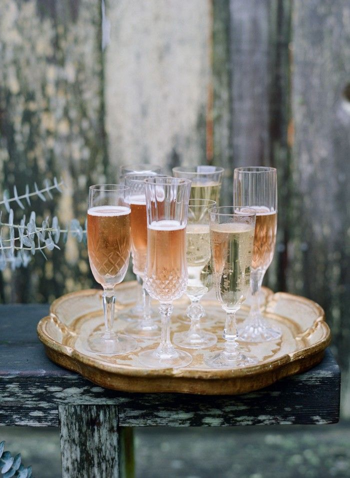 Mix & Match. Don't have a matching set of glassware to accomodate your whole group? Don't sweat it! Mixing and matching similar champagne flutes makes for a presentation that's just as pretty and a lot more interesting.
