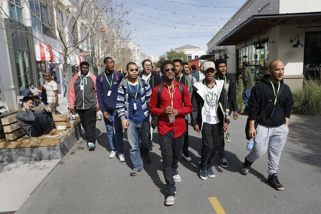 Students from Gateway High School, in San Francisco, and Castlemont High School, in Oakland, tour the campus at Facebook in Menlo Park, Calif., on Friday, Feb. 26, 2016. African American students from San Francisco, Oakland and San Mateo visit the company to learn about a career in technology, computer science and engineering. (Jim Gensheimer/Bay Area News Group)