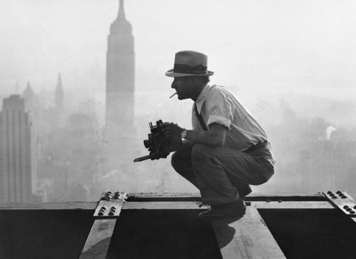 "Charles Ebbets preparing for his ""Lunch atop a Skyscraper"" photograph in 1932. He is perched on the 69th floor of the GE building."
