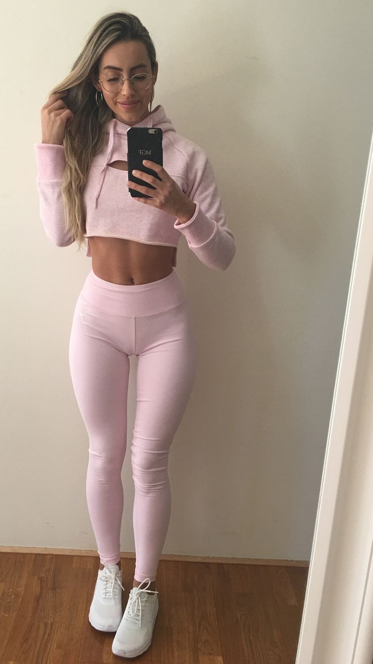 632b7854c1216 Gymshark Athlete, Madalin Giorgetta styling the Cropped Raw Edge Hoodie and  Dreamy Leggings, both in Chalk Pink.