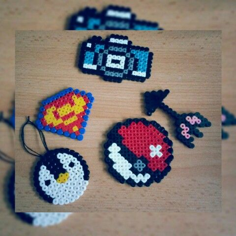 Throwback to childhood.  #hama #hamabeads #arrow #penguin #pokeball #camera #superman #040415