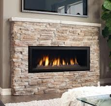linear gas fireplace - surrounded by stone. Love for master bedroom, den, or living room!