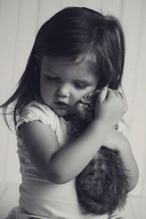 Awwwww…… I remember what a cuddle from a cat meant to me when I was that little….the same as it does now!