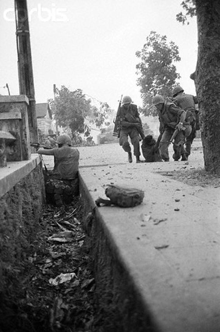 Marines drag a fallen comrade to safety in Hue City, 1968 ~ Vietnam War