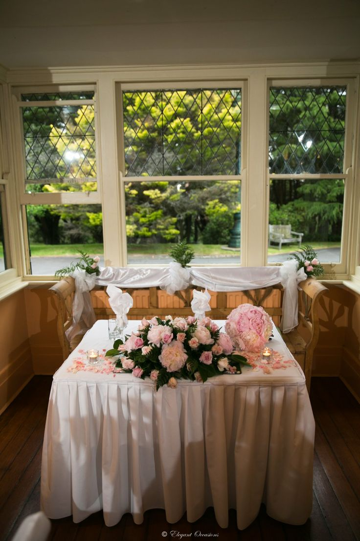 Veronika's wedding was a small elegant affair at the Glendower Restaurant. Beautiful weather, spectacular views and the smell of pink peony roses created a romantic atmosphere for a perfect day. Guest table vases were filled with crystals and pearls to complement the bride's dress. Photography by Jason Vannan. The stunning …