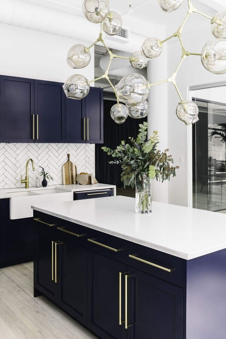 Stunning blur cabinets with gold details.