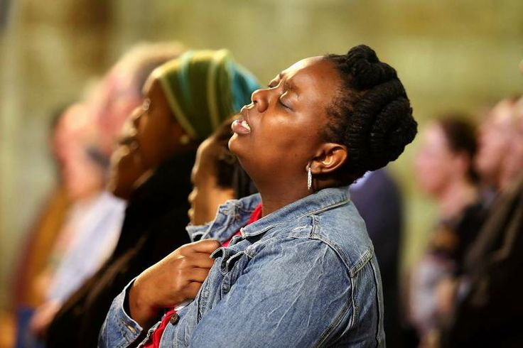A mourner sings the South African National anthem and hymn Nkosi Sikelel' iafrica during a mass at St Georges Cathedral in Capetown followin...
