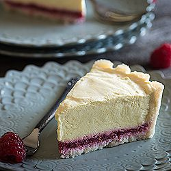 A beautiful raw, gluten free, vegan Meyer lemon tart with a raspberry jam layer.