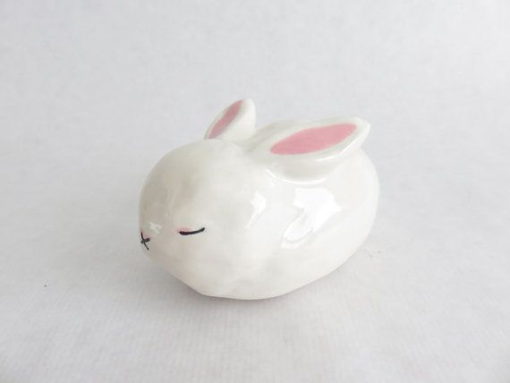 Sleeping rabbit, sweet sculpture. Size 7cm(2.7inch) wide,6cm (2.3inch)high,12cm (4.7inch)deep,around 200g.  Inside is hollow. White stoneware casted