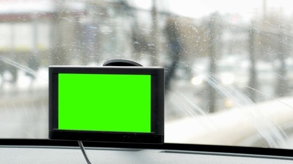 GPS Device Makes Driving In The City Easy by Grey_Coast_Media Close-up shot of GPS device with chroma key in moving car, windscreen wipers working You can also download this footage in extreme