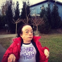 """To the left is a picture of Liz Carr, shared with her permission, that was taken as she arrived at the """"Holy Grail of assisted suicide tourism, the Little Blue House aka Dignitas"""" (taken from her description of the photo on Facebook). http://blog.noeuthanasia.org.au/2013/02/bbc-liz-carr-presents-when-assisted.html"""