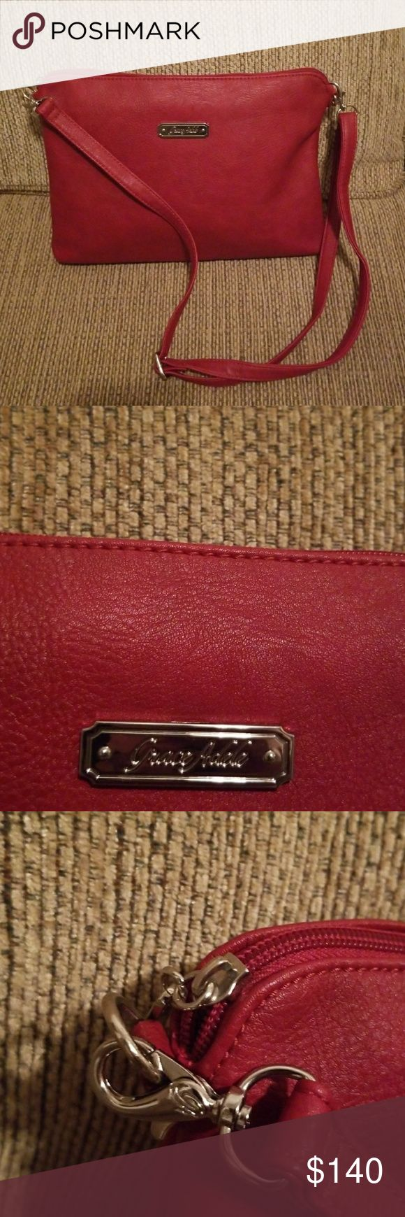 Grace Adele crossbody bag Dark red GA crossbody adjustable shoulder strap. Excellent condition and its as close to new as you can get, without the tags👍👌. SORRY🚫No offers on this bag.🚫 Grace Adele Bags Crossbody Bags