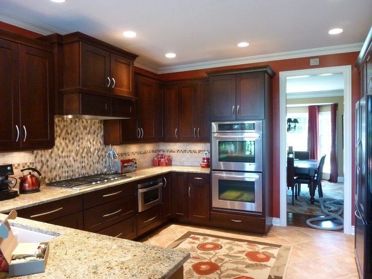 Cherry Gingersnap Cabinetry From Medallion Is The Perfect Backdrop For The  Tumbled Stone Backsplash From Tiles International. Crackled Glass Accent  Tiles ...
