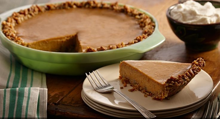 Spiced Pumpkin Pie with Pepita Crust - Pumpkin seeds in the pie crust sounds interesting...and I want that pie pan, too!