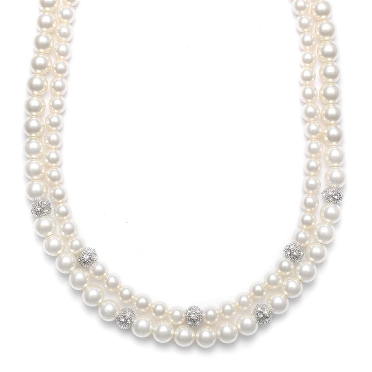 This double strand ivory pearl bridal necklace has a row of 5mm pearls nested in a row of 6mm pearls both accented with silver micro-pave CZ balls.