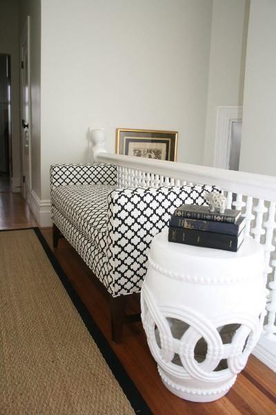 Beautiful entryway    Pottery Barn settee, sisal rug and white garden stool.