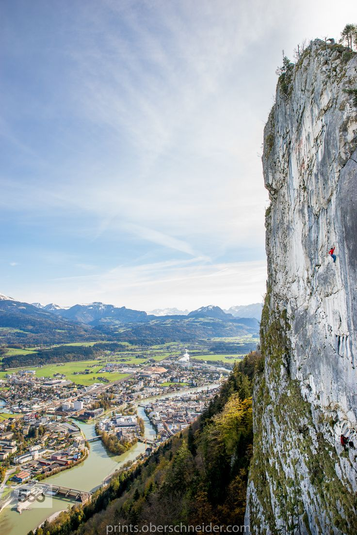 Rock climbing high above the city by Christoph Oberschneider on 500px