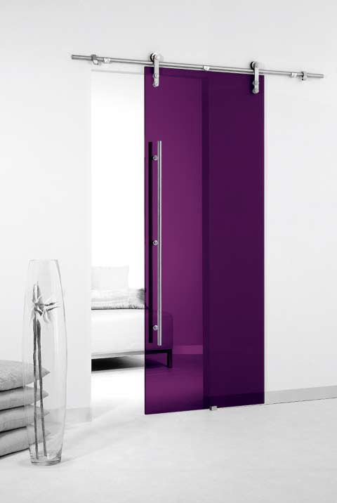 Colored Glass Sliding Door with Exposed Sliding Hardware LOVE IT!